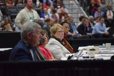 Sandy Lutz seated with the Judicial Council