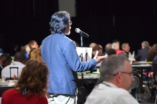 A delegate speaks from the floor