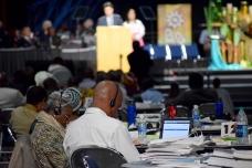 Delegates listen to translations