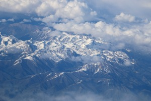 Rocky Mountains view from inside plane